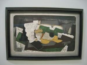 G. Braque. Guitare et verre ou Socrate à la nature morte à la partition de Satie. 1921. Centre Pompidou
